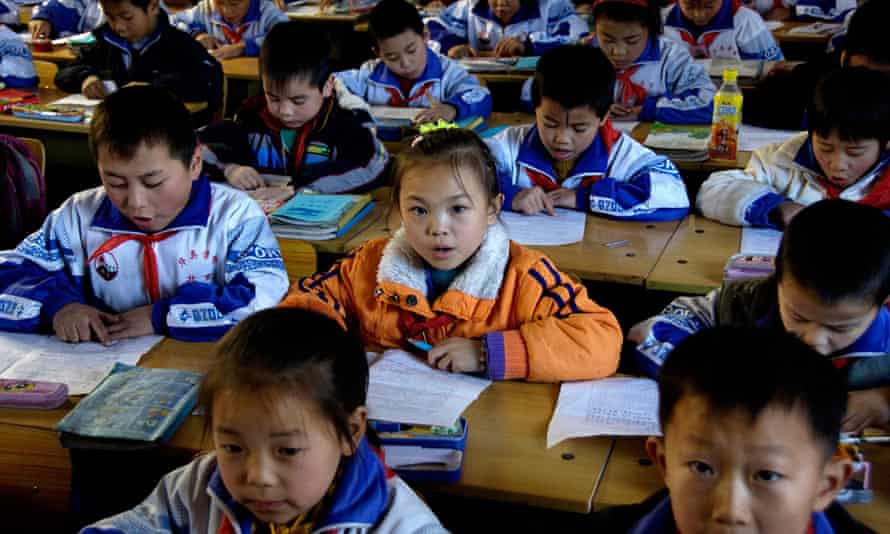 Pupils study inside a classroom in China
