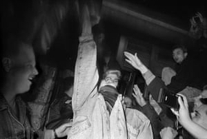 crowd celebrating after fall of berlin wall