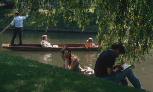 Students catch up with their reading on the banks of the river Cam, near Trinity College, Cambridge, August 1970.