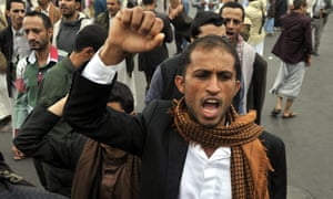 A Yemeni shouts anti-government slogans at the site of the suicide bombing.