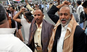 Yemenis shout anti-government slogans after a suicide bomb blast at Tahrir Square in Sana'a