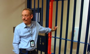 Two Rivers Regional Detention Facility Warden Ken Keller waits for a locked gate to be opened.