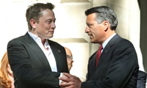 Elon Musk, left, shakes hands with Nevada Gov. Brian Sandoval following a news conference where Nevada was announced as the new site for a car battery gigafactory.