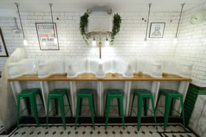 Original urinals and cisterns converted into a counter  in Attendant