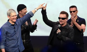 Apple CEO Tim Cook, left, greets Bono after U2's performance at the launch of the iPhone 6 in California last month.