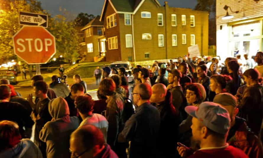 A crowd gathers near the scene on Shaw Boulevard where a man was fatally shot. st. louis st louis police vanderitt myers