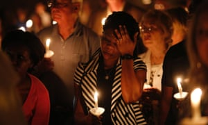 Mamie Mangoe wipes a tear away during a memorial service for Ebola victim Thomas Eric Duncan.