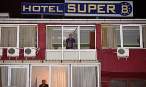 Guests quarantined in the Hotel 'SUPER 8' look out from their windows, being not allowed to leave the hotel in Skopje, The Former Yugoslav Republic of Macedonia, 09 October 2014.