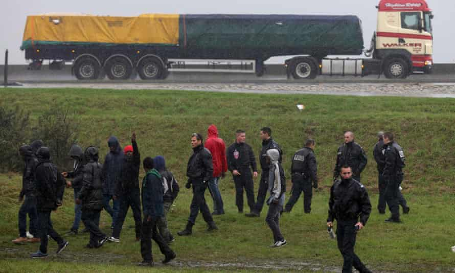 The road to El Dorado? French police stop migrants attempting to board a lorry bound for Britain.