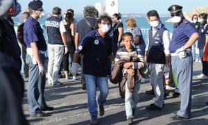 Migrants land at the Sicilian port of Pozzallo
