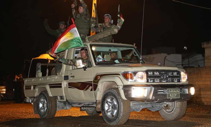 Kurdish peshmerga forces arrive in Suruc, near Turkey's border with Syria, en route to Kobani