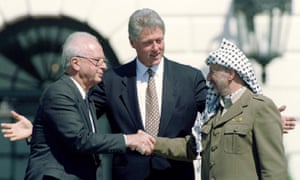 Palestinian President Yasser Arafat is seen with U.S. President Bill Clinton and Israeli Prime Minister Yitzhak Rabin after the signing of the Israeli-PLO peace accord at the White House, September 13, 1993
