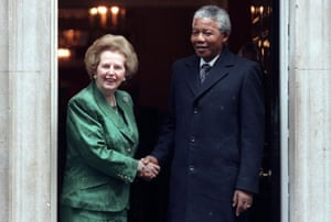 African National Congress leader Nelson Mandela is greeted by British Prime Minister Margaret Thatcher at 10 Downing Street on July 4, 1990 prior to their talks