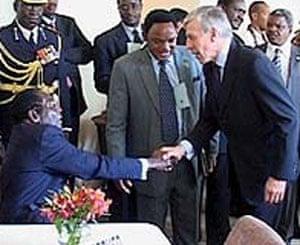 Jack Straw shaking hands with Robert Mugabe - BBC Newsnight