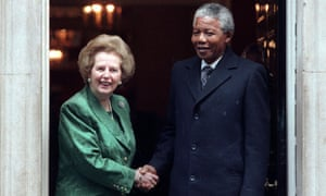 African National Congress leader Nelson Mandela (R) is greeted by British Prime Minister Margarat Thatcher at 10 Downing Street