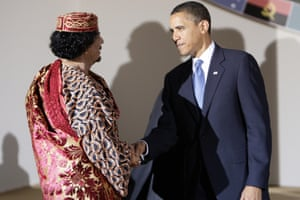 US President Barack Obama (R) and Libyan Leader Moamer Kadhafi shake hands during the Group of Eight (G8) summit in L'Aquila, central Italy, on July 9, 2009