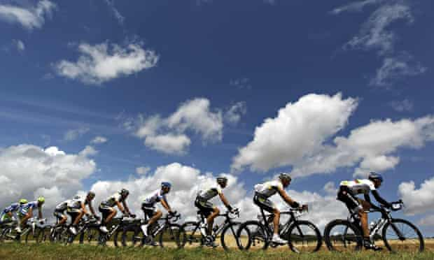 cyclers riding beneath cloudy sky
