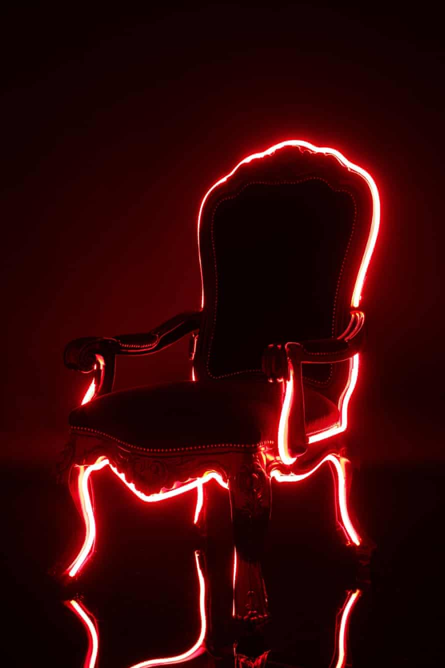The Electric Louis, hand carved in mahogany, lacquered and adorned in neon