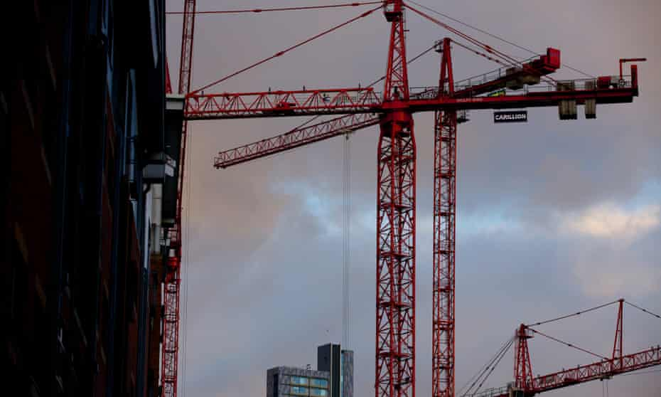 Construction cranes at work on a new city development.