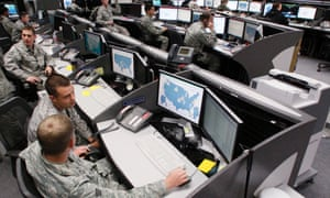 Personnel work at the air force space command network operations & security center at peterson air force base. U.S. national security planners are proposing that the 21st century's critical infrastructure -- power grids, communications, water utilities, financial networks -- be similarly shielded from cyber marauders and other foes.