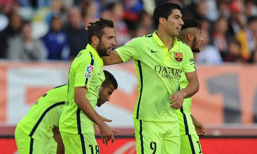 Jordi Alba  celebrates with  Luis Suárez after scoring his team's second goal.