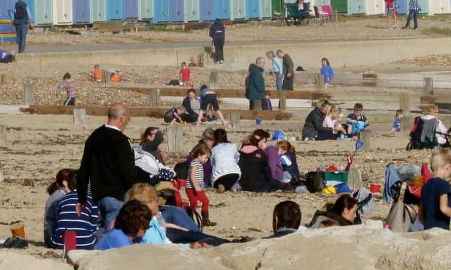 Beachgoers enjoy the unseasonably warm late October weather ion Avon beach in Christchurch, n Dorset