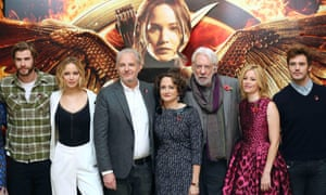 Cast members Liam Hemsworth, Jennifer Lawrence, director Francis Lawrence, producer Nina Jacobson, cast members Donald Sutherland, Elizabeth Banks and Sam Claflin, attend the photocall for The Hunger Games: Mockingjay, part 1 in London.