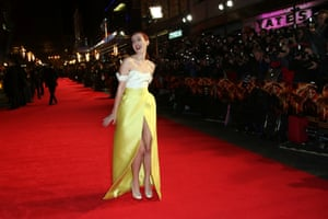 Actress Jena Malone, who plays Johanna Mason, poses on the red carpet for photographers upon arrival at the premiere.