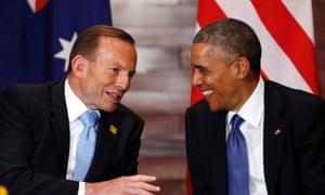 Tony Abbott and Barack Obama share a lighter moment in Beijing.