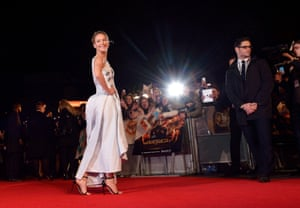 Jennifer Lawrence takes in the adoration of the fans as photographers' bulbs light up her night ahead of the film's first screening.
