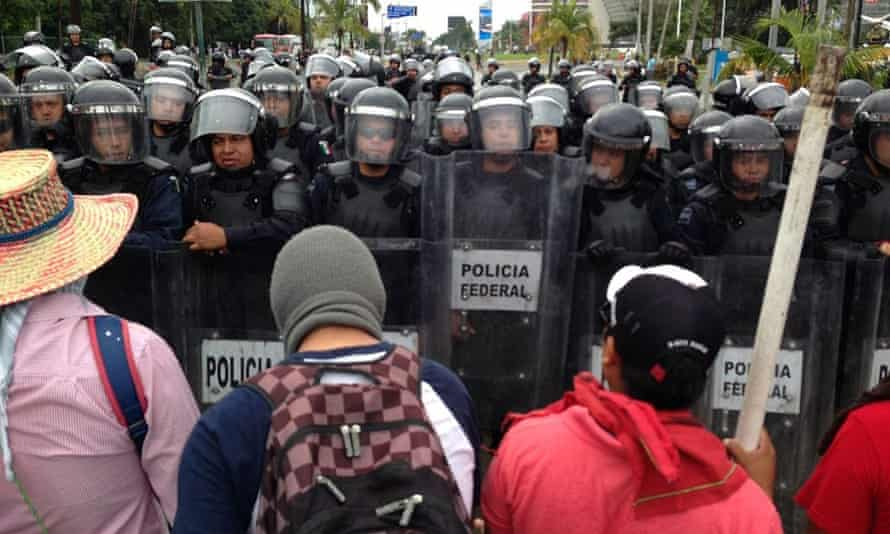Mexican riot police block a street as demonstrators protest in Acapulco over the killing of 43 Mexican students.