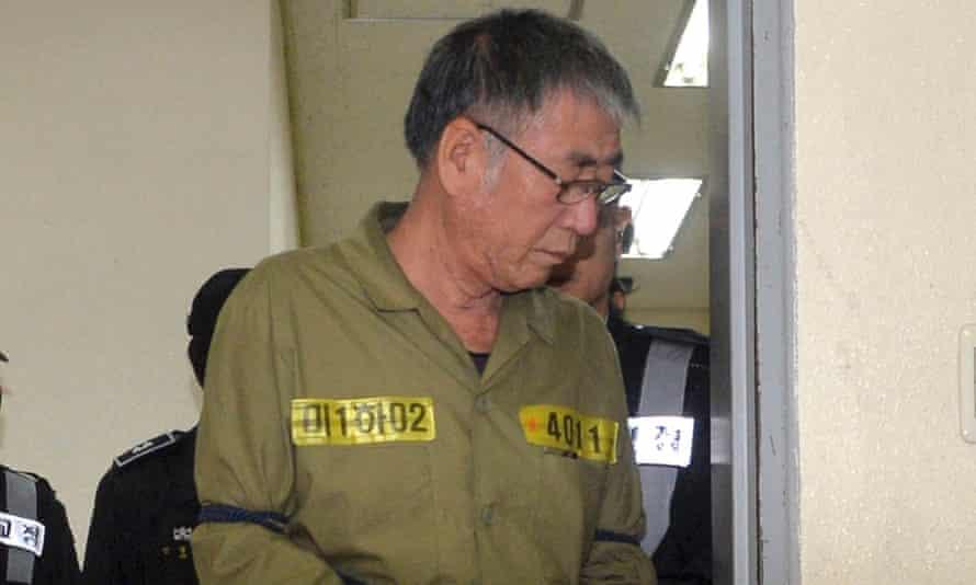 Lee Joon-seok, the captain of the Sewol, arrives to hear the verdict.