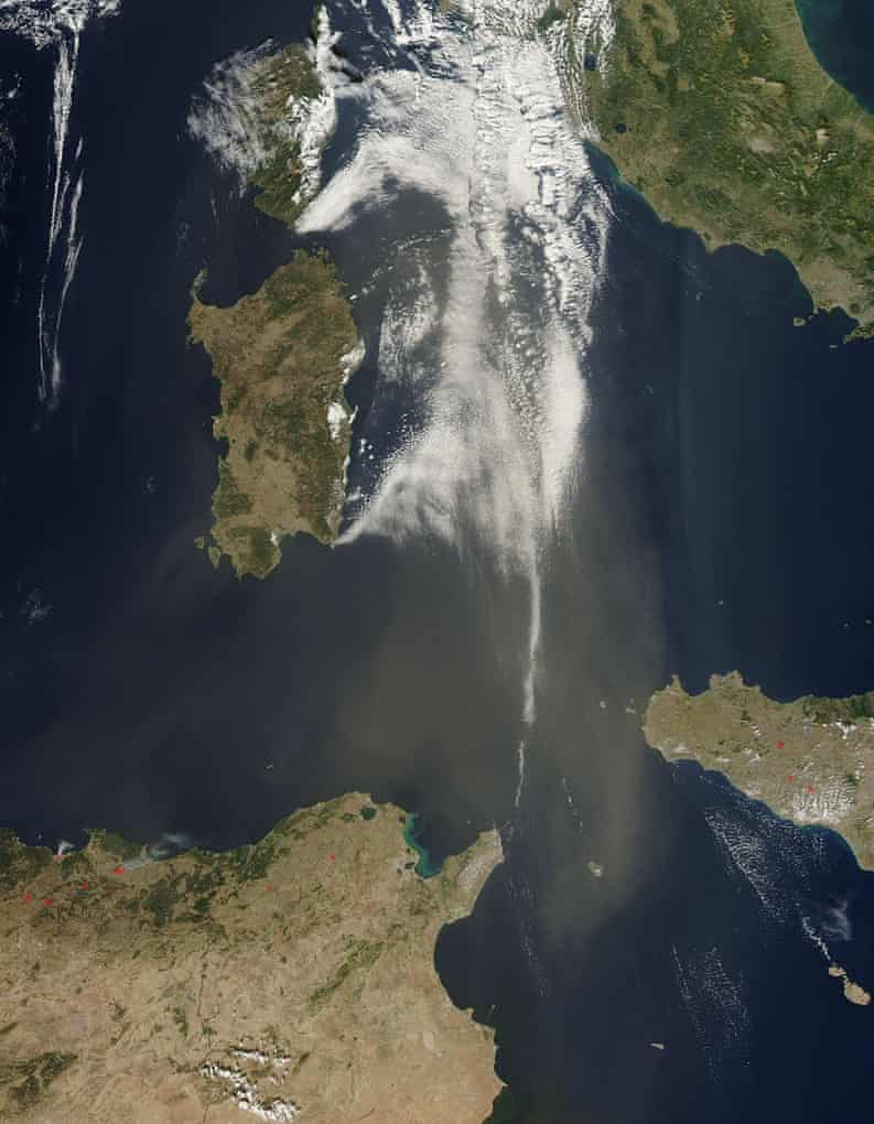 A broad stream of tan dust blew over the Mediterranean Sea in mid-October, 2014, carrying Saharan dust northward toward Europe.