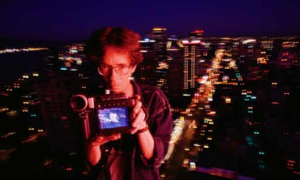 Writer William Gibson holding a video camera in Vancouver, Canada in 1993.