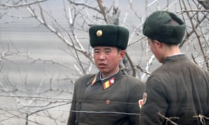 North Korean soldiers as seen from across the border in China.