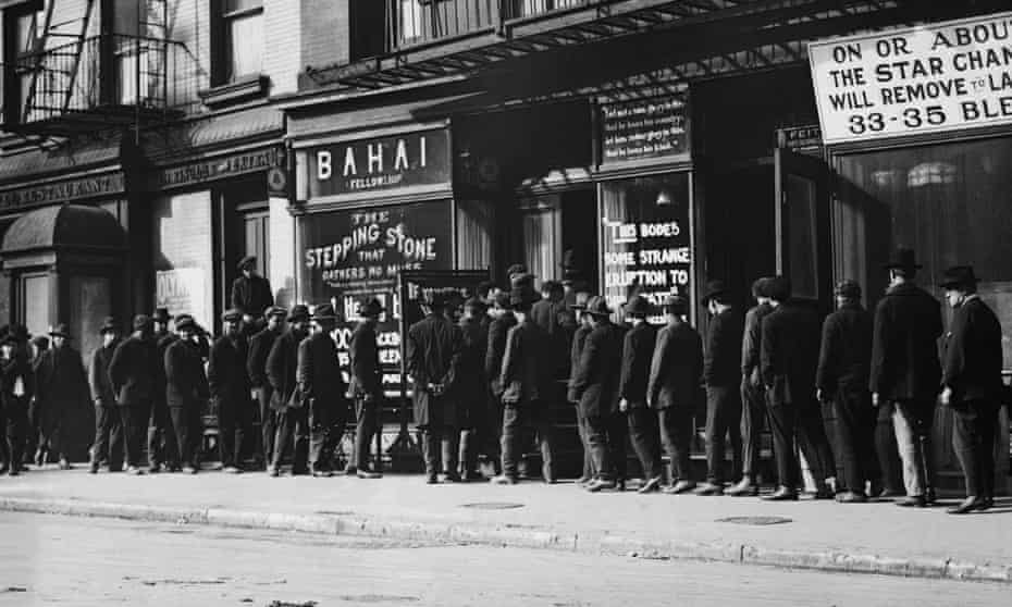 Unemployed men queuing for coffee and bread at a soup kitchen in New York, circa 1930.