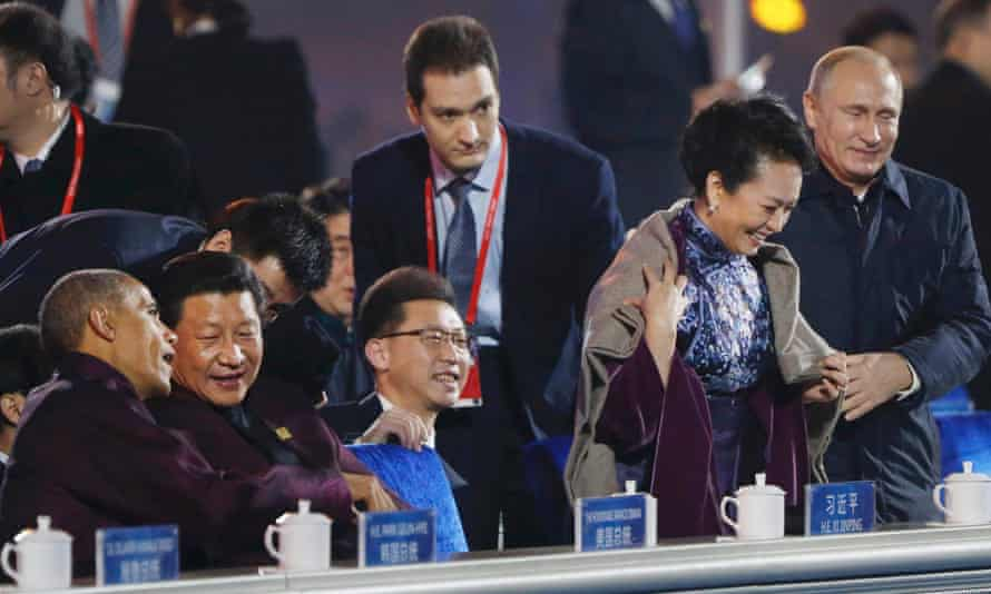 Putin's gallant gesture came as Peng's husband, Xi Jinping, chatted to Barack Obama.