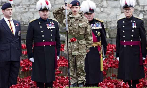 Cadet Harry Hayes salutes after planting the last poppy at the Tower of London on Armistice Day