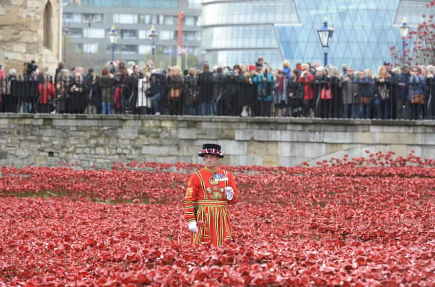 The two minute silence is observed at the 'Blood Swept Lands and Seas of Red' poppy installation at The Tower of London.
