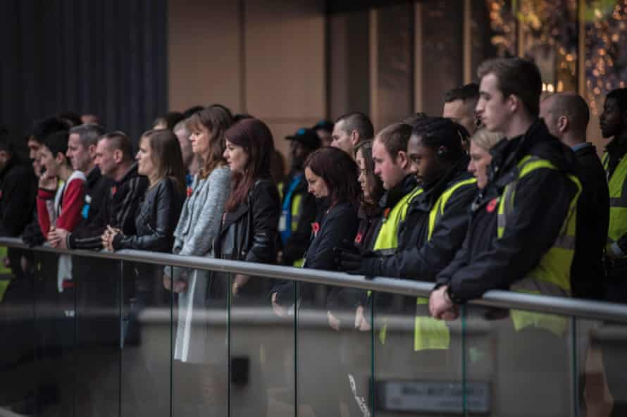 Staff from Cabot Circus shopping centre in Bristol pay their respects during the two minute silence.