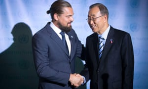 Actor Leonardo DiCaprio (L) and United Nations Secretary General Ban Ki-moon shake hands