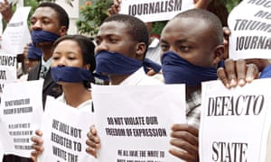 Zimbabwean journalists from the independent and foreign press protest outside Parliament in Harare,