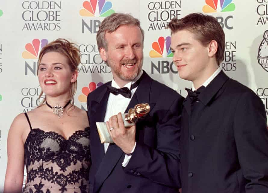 James Cameron, Kate Winslet and Leo pose at the Oscars after Titanic's night of triumph.