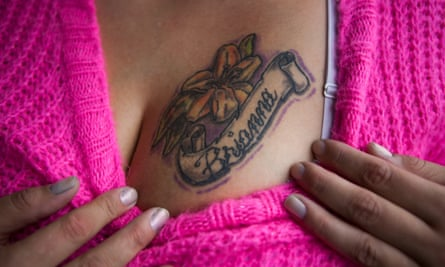 Andrea Cathey, a human trafficking survivor, shows off her tattoo.