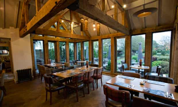 Wooden rafters and panelled windows of the Nag's Head