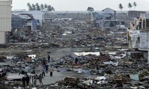 Tsunami survivors search through debris at Banda Aceh, the capital of Aceh province in northwest Indonesia, December 31, 2004