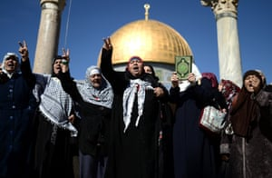 Women shout slogans in front of the Dome of the Rock, near the al-Aqsa mosque where a police raid led to widespread outrage in the Muslim community