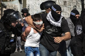 Israeli police detain a Palestinian youth following clashes after Friday prayers in the East Jerusalem neighbourhood of Wadi al-Joz