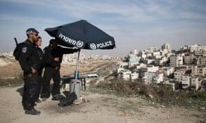 Israeli Border Police take position on a hill overlooking the east Jerusalem Arab neighborhood of Issawiya today