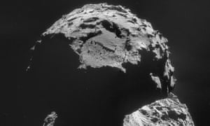 The comet as seen by the Rosetta spacecraft on 6 November. The landing site chosen for its lander, Philae, can be seen close to the top of the image above a large boulder-filled depression.